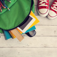 school-backpack-on-wooden-background